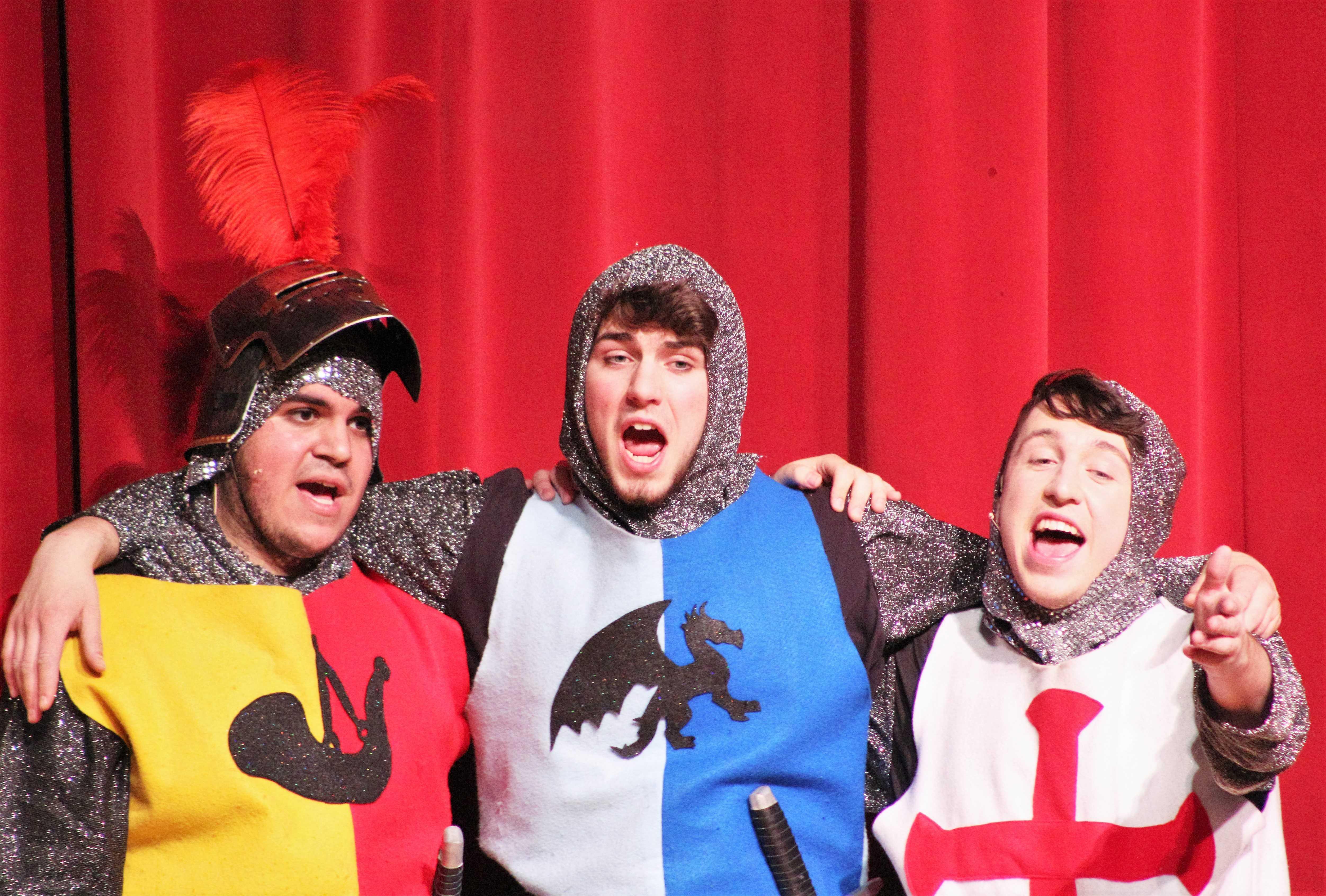 Bedevere (Zack Carme), Lancelot (Buren Andrews), and Galahad (Jack Snow) sing