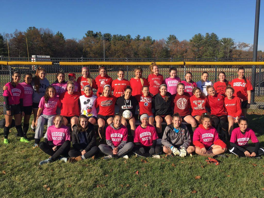 HHS+soccer+team+and+HHS+alumni+come+together+and+take+pictures+with+friends%2C+teammates%2C+and+coaches.+