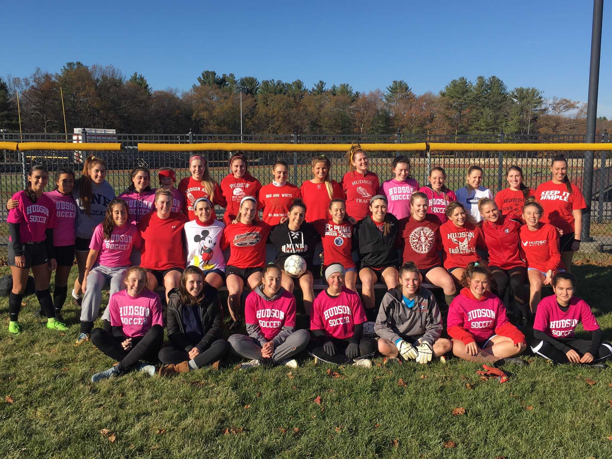 HHS soccer team and HHS alumni come together and take pictures with friends, teammates, and coaches.