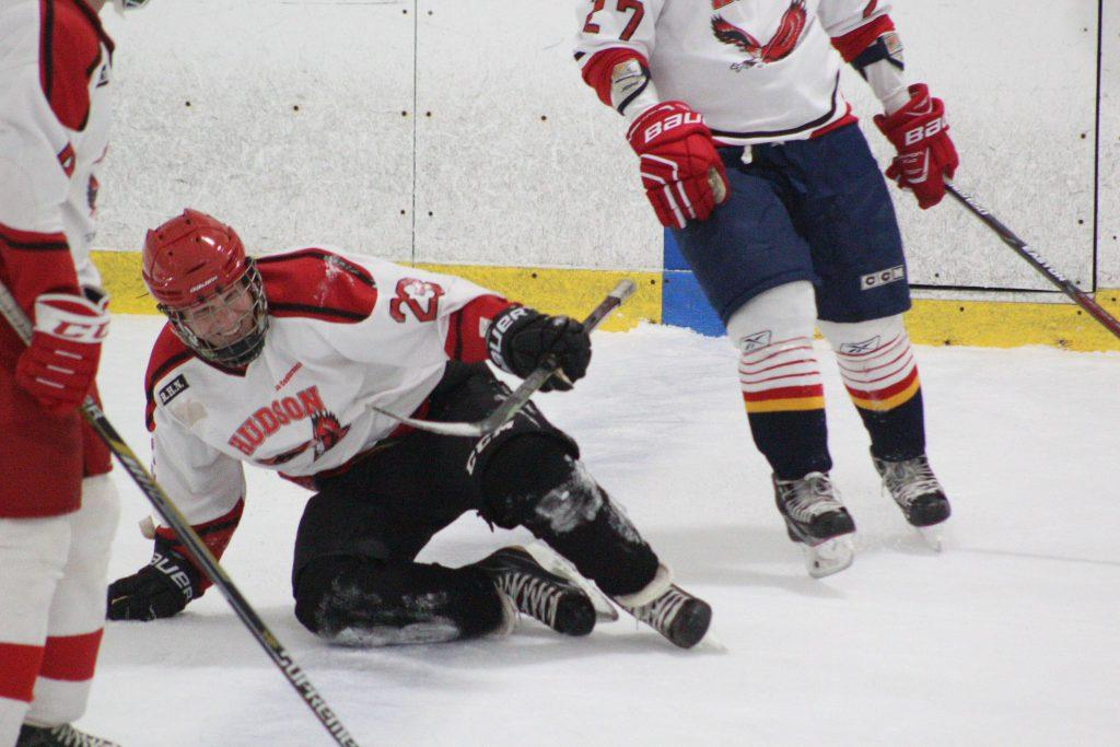 Tim+Reinhardt+slides+onto+the+ice+laughing+after+an+attempt+to+steal+the+puck.++%7C+by+Ally+Jensen