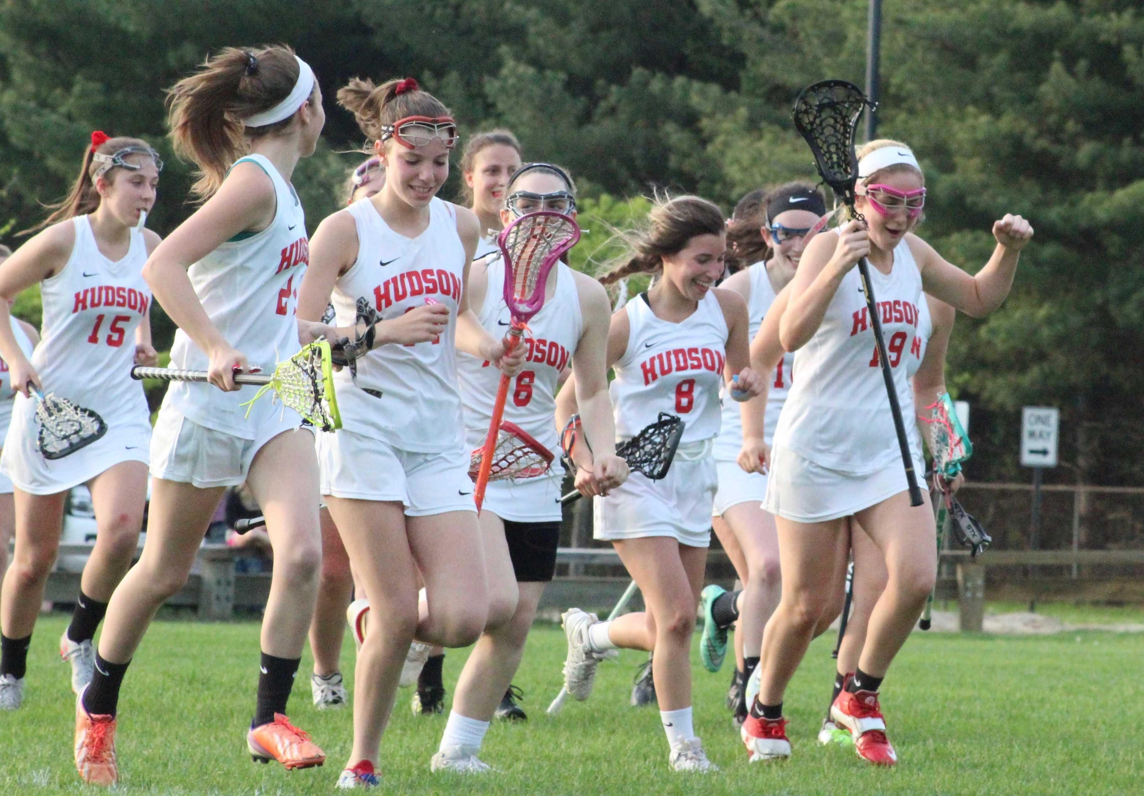 The Hawks cheer as they run over to the bench after defeating Marlborough 12-11 in over time.   by Siobhan Richards