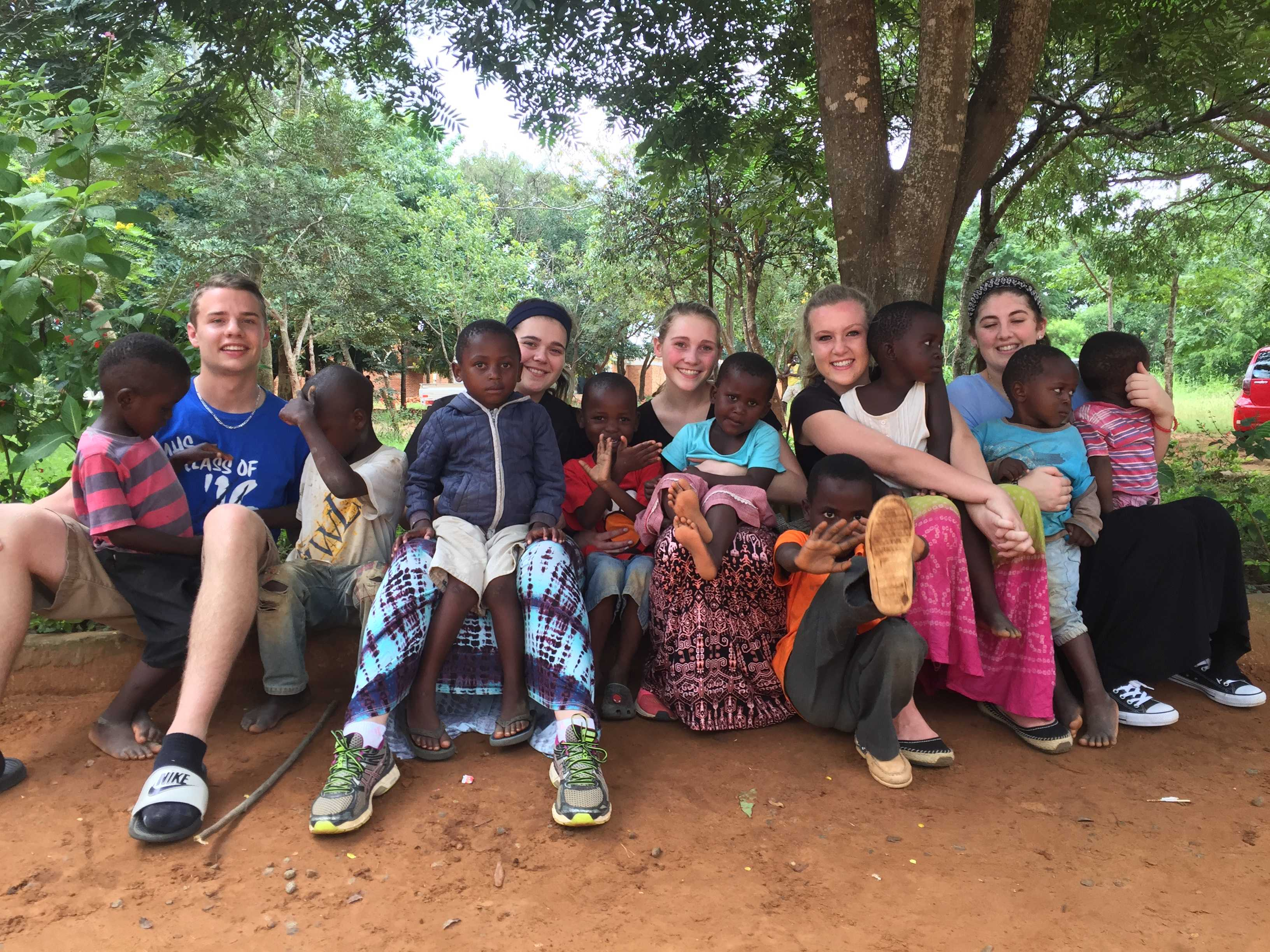 Samantha McLaughlin and several other students hold children from villages in Malawi. | by Samantha McLaughlin