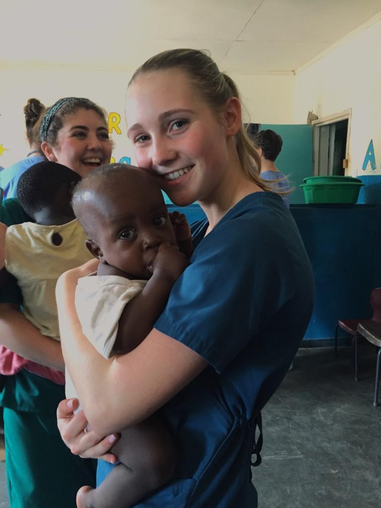 Samantha+McLaughlin+holds+a+child+from+Malawi.+%7C+by+Samantha+McLaughlin