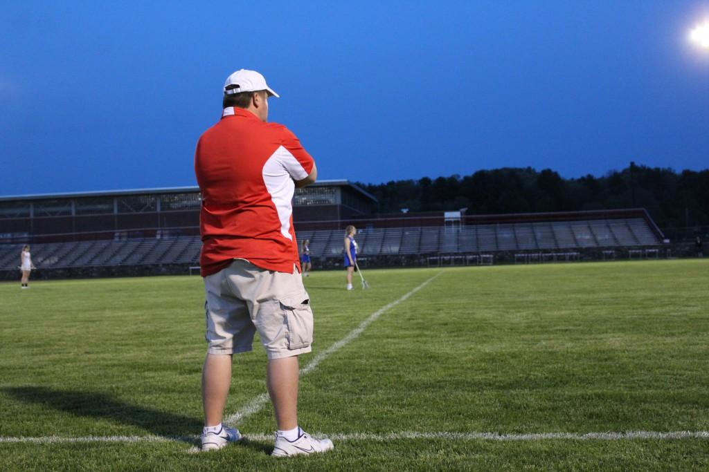 Girls lacrosse coach Richard Fulvi on the sidelines during a game against Lunenburg in the Morgan Bowl. | by Allura Carney