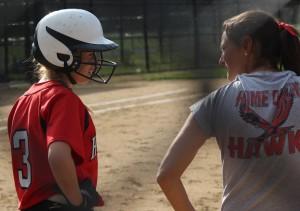 Junior Sydney Chiasson talks with Coach Mary Beth Cashman before Tuesday