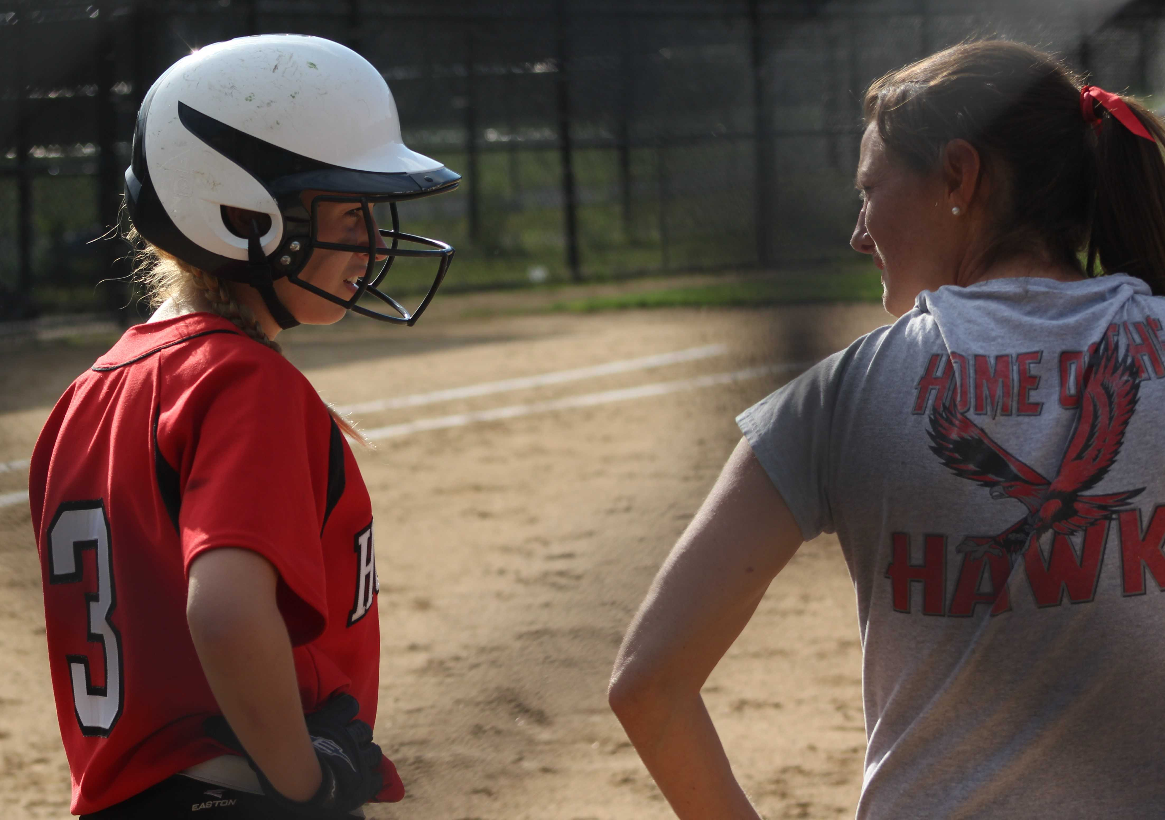 Junior Sydney Chiasson talks with Coach Mary Beth Cashman before Tuesday's game. Hudson would lose to Doherty 3-0 ending their season.| by Dakota Antelman