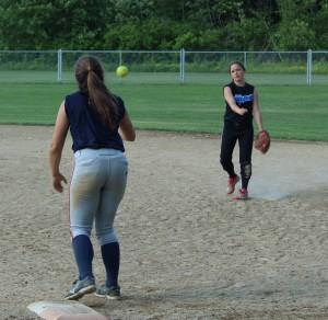 Keeliey Zompetti throws a ball to Haley Gaffney during practice. | by Dakota Antelman