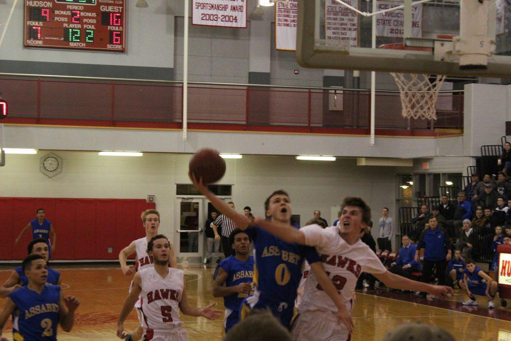 Gerard McManus goes up for another layup and gets it in. | by Brianna Cabral