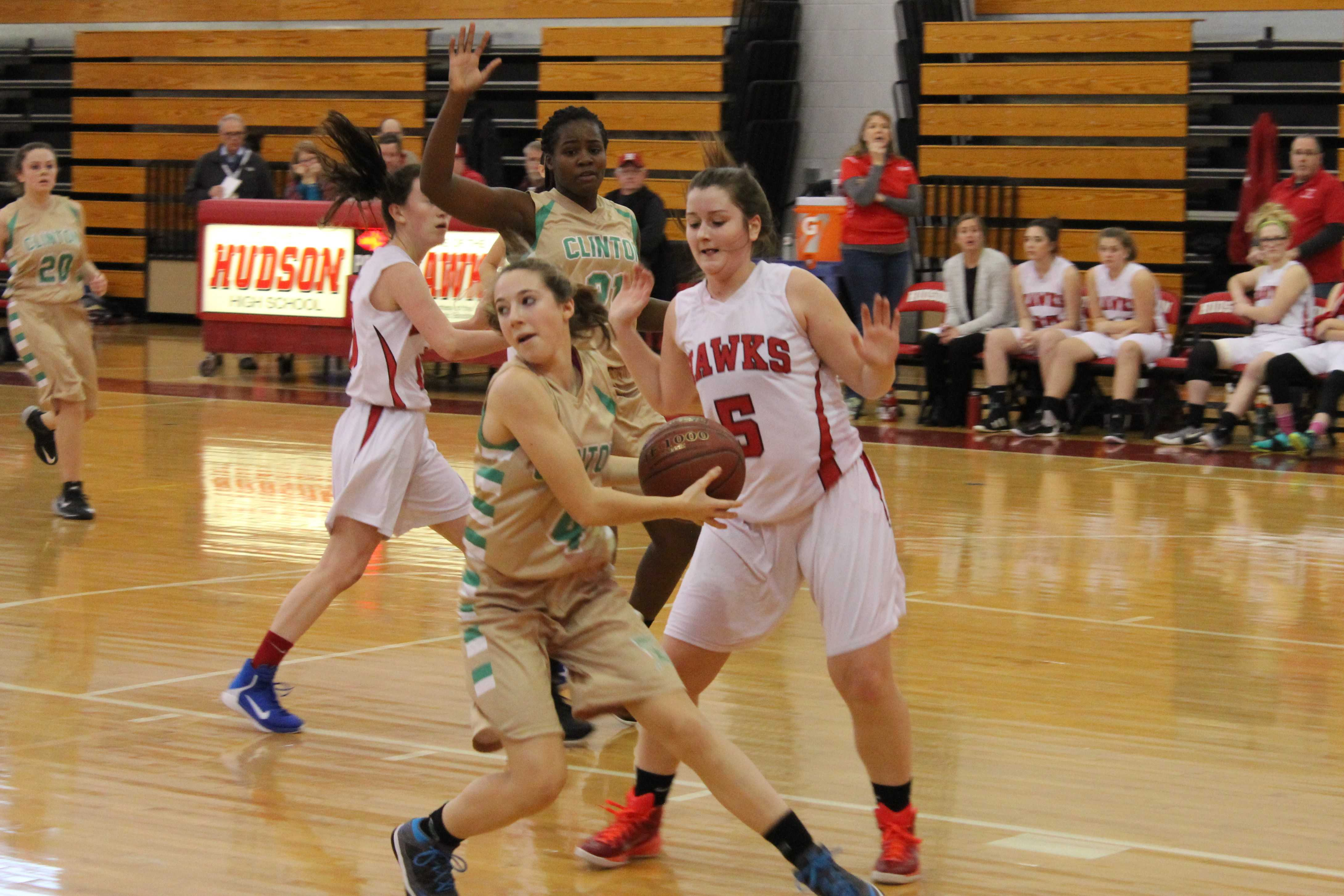 Regan Gannon spins away from the defense of Hudson's Emily O'Neil in the second quarter. | by Dakota Antelman