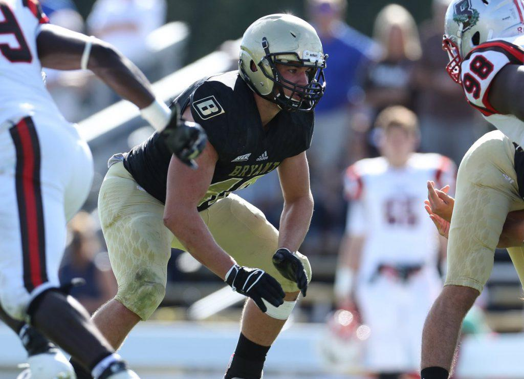 Jessie Nemerowicz, rookie linebacker at Bryant, sets up at the line before the play, against Brown. | photo from Maria Nemerowicz