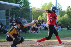 Maddie Haufe swings on a pitch during the game. Haufe would later tie the game with a two run double in the seventh inning. | by Siobhan Richards.