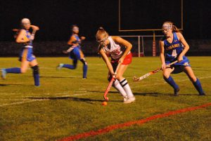 Emily White rushes past Assabet defenders with the ball early in the first half. | by Dakota Antelman