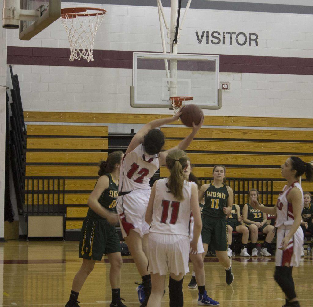 Hudson is taking a shot toward the net.   by Lily Clardy