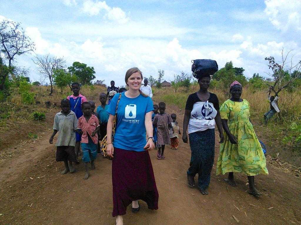Kathrine+Neff+walks+with+villagers+towards+a+new+water+source+for+a+Ugandan+community.+%7C+Submitted+photo