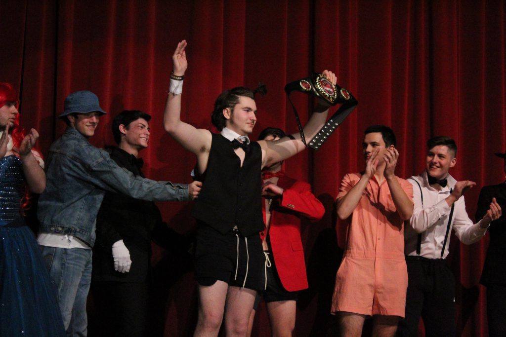 Junior+Cam+Miele+is+pronounced+the++winner+of+Friday%27s+%22Mr.+HHS%22+pageant+after+being+handed+the+trophy+belt+by+senior+Tim+Cabral.+%7C+by+Siobhan+Richards