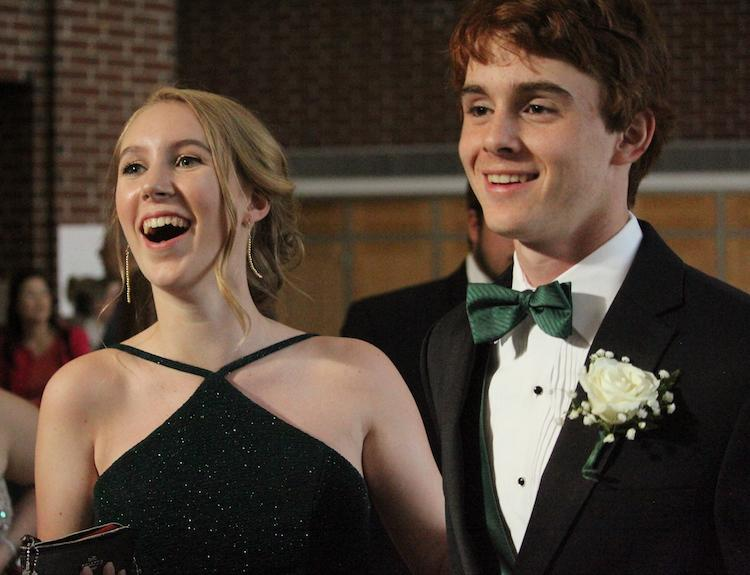 Ben Chase poses with date Louisa LeBourdonnec of Algonquin Regional High School at the 2018 Hudson High School prom. | by Clement Doucette