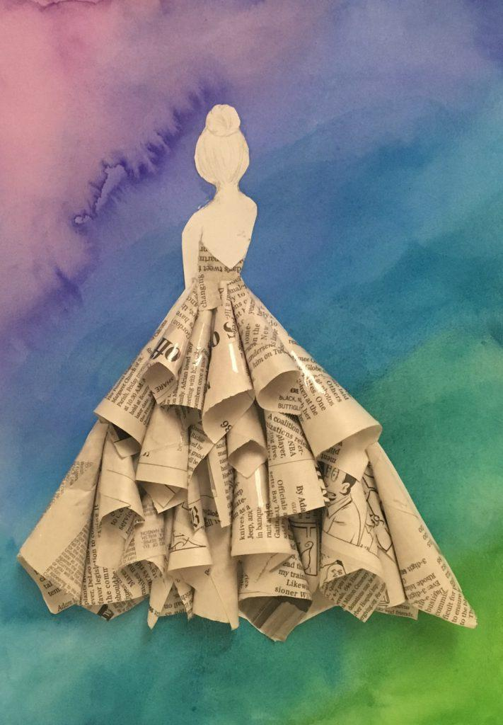 Kayla Popovich created a dress made out of newspaper. She wanted a colorful background, so she took purple and blue and painted the background. | by Lily Clardy