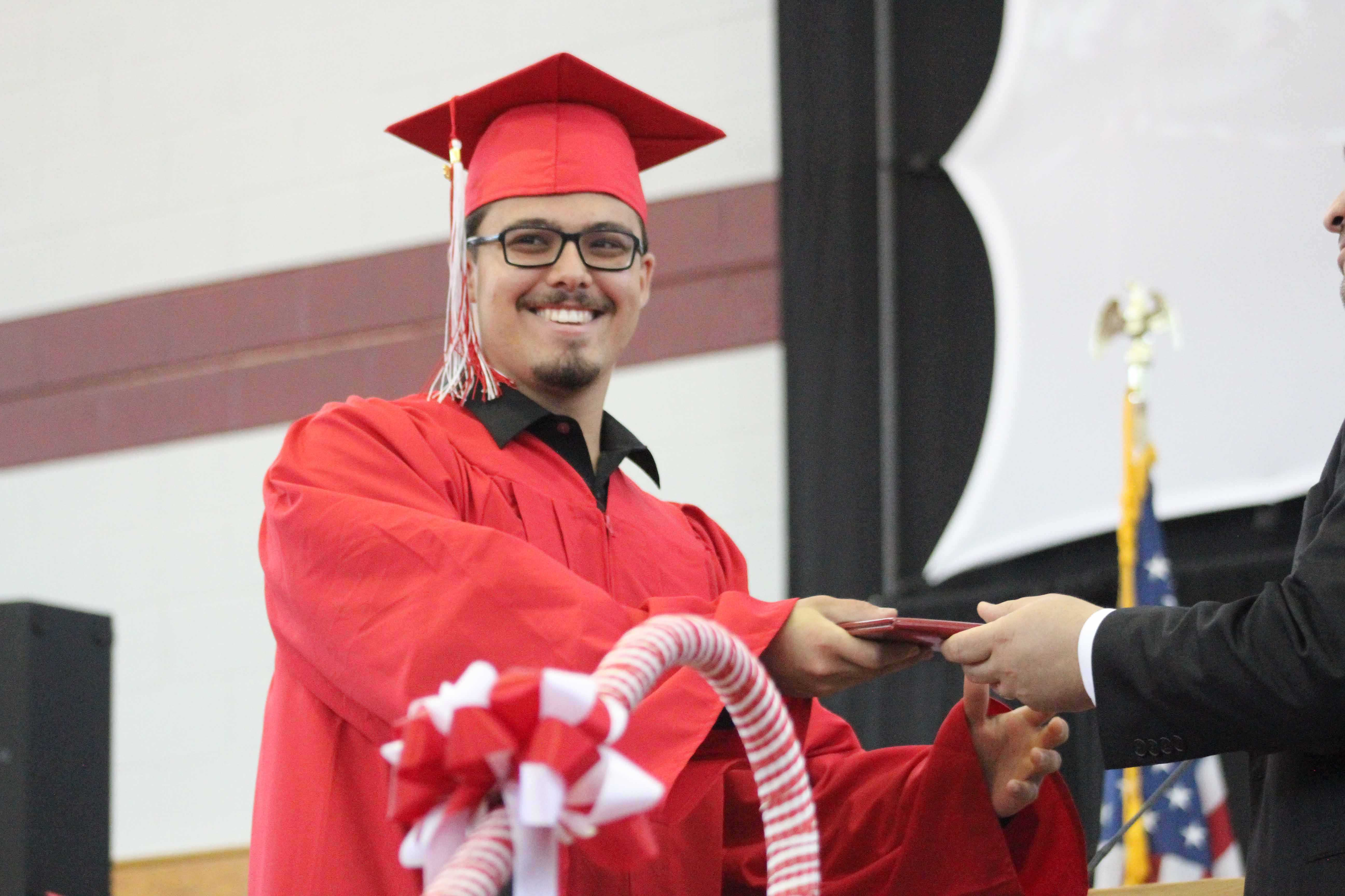 Nicholas Bassetti receives his diploma.  |by Ally Jensen