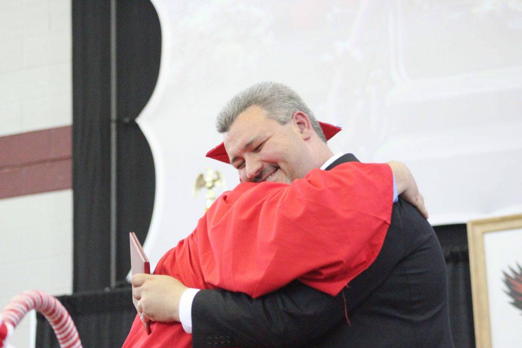 Jordan+Bushey+gives+Principal+Reagan+a+hug+instead+of+a+handshake.++%7Cby+Ally+Jensen
