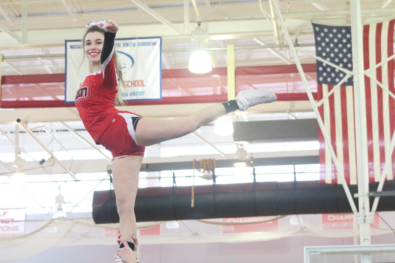 Senior+Kenzie+Tinglof+flying+in+the+second+stunt+%7Cby+Brianna+Devlin