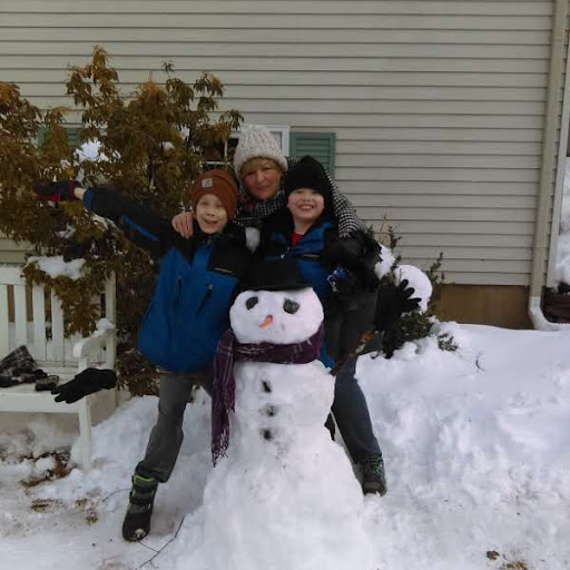 Librarian+Assistant+Christine+Alexander+and+her+grandsons+enjoyed+a+romp+in+the+snow.