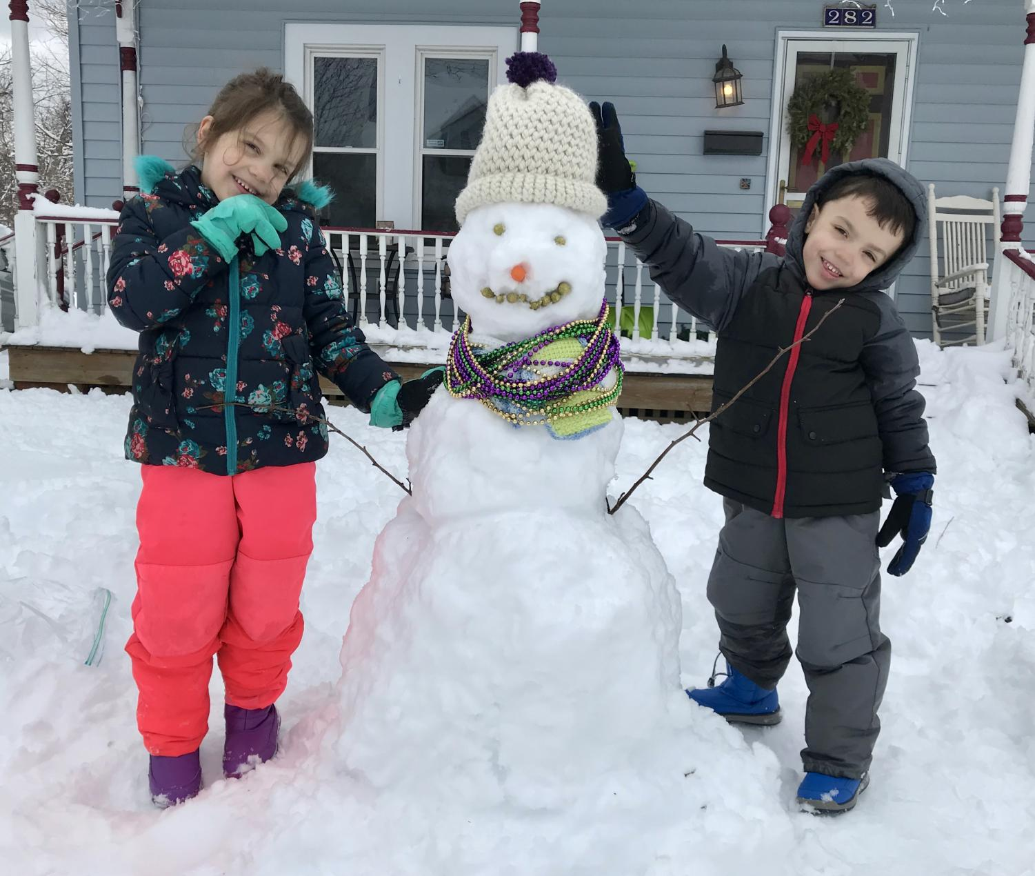 English+Teacher+Amy+Plackowski%27s+children+Myka+and+Asher+with+%22Fred%2C+the+Mardi+Gras+Snowman%22+hamming+it+up.