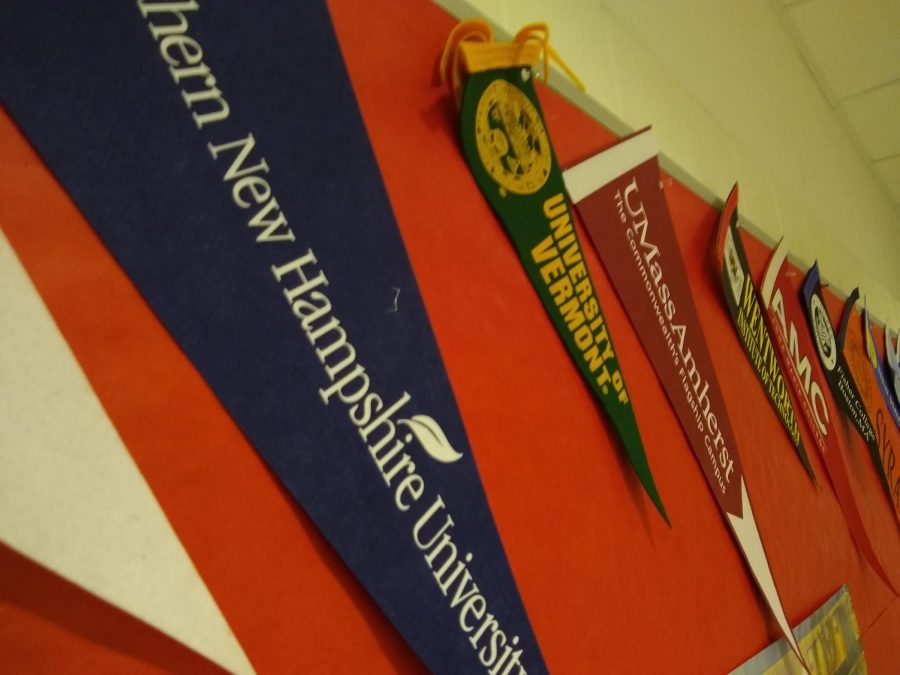 Flags of colleges students are attending coat the guidance hallway |by Veronica Mildish