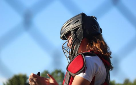 Catcher, Caitlin Cassidy (4) preparing for the game |by Brianna Devlin