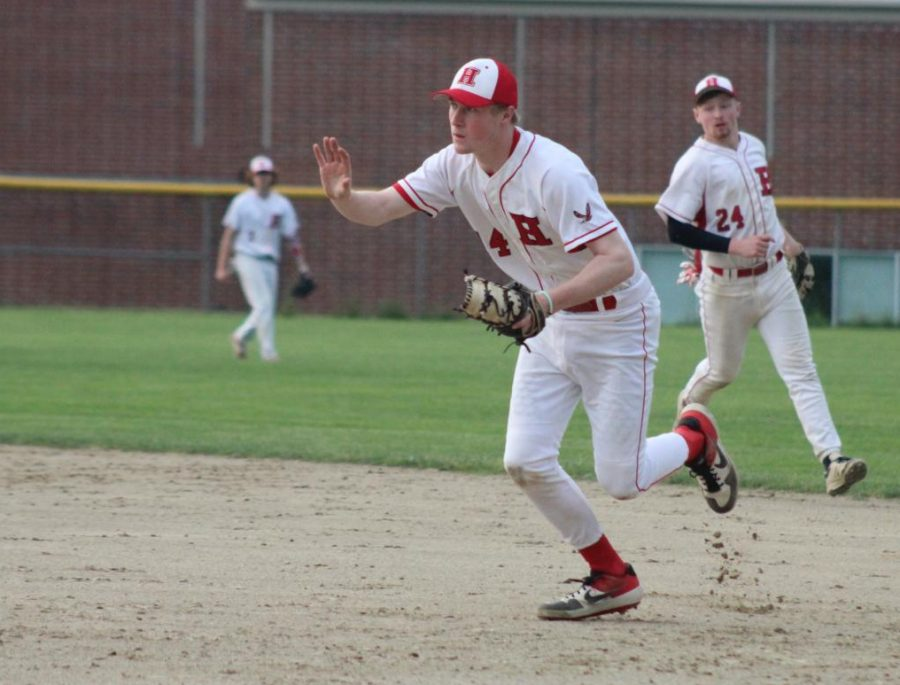 Tim Person (14) calls the ball at first base |by Brianna Devlin