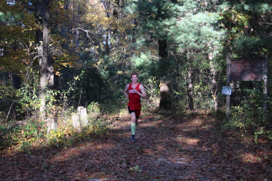 Daniel Cuddy flying through the path getting first place in the race ageist AMSA , his time was 16:05.
