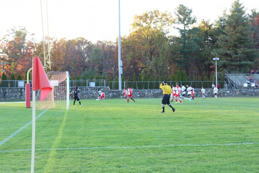 hudson moves torwed the goal as the other team fails to keep the ball | by camilla miranda