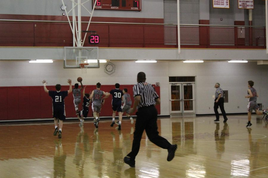 sophomore  Panashe Dowa goes in for a shot.