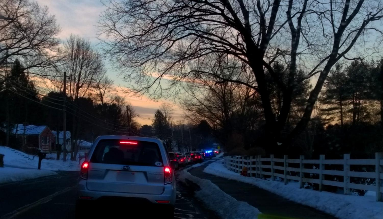 Cars haulted as police tend to an accident in the HHS driveway |by Veronica Mildish