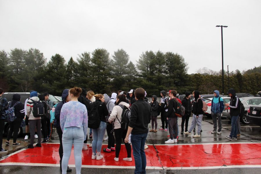 Students stand in solidarity after leaving the school