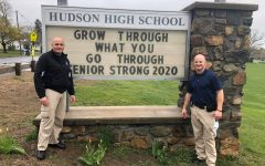 Hudson Police School Resource Officers Detective Chad Crogan and Detective Seamus Veo stand in front of their updated sign at HHS | photo provided by Hudson Police Department