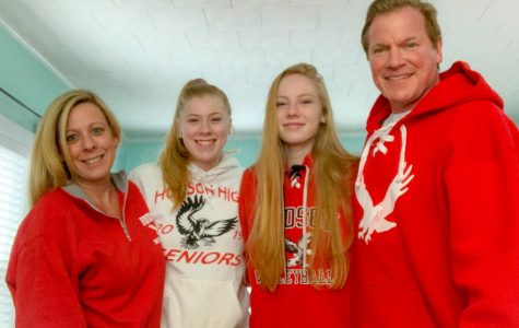The Johnson family shows school spirit in red and white HHS sweatshirts | Photo Provided by The Johnson Family