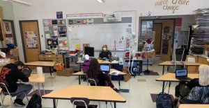 Art teacher Erin Jameson instructs students simultaneously on Google Meet and in person   by Lilla Gaffney