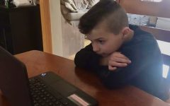 Second-grader Jacob Hermann studies during online classes | Photo Courtesy of Stephanie Hermann