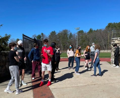 Students take a mask break on Friday. Mask breaks will become more structured and scheduled once students return full time after April Vacation | Photo by The Big Red Staff