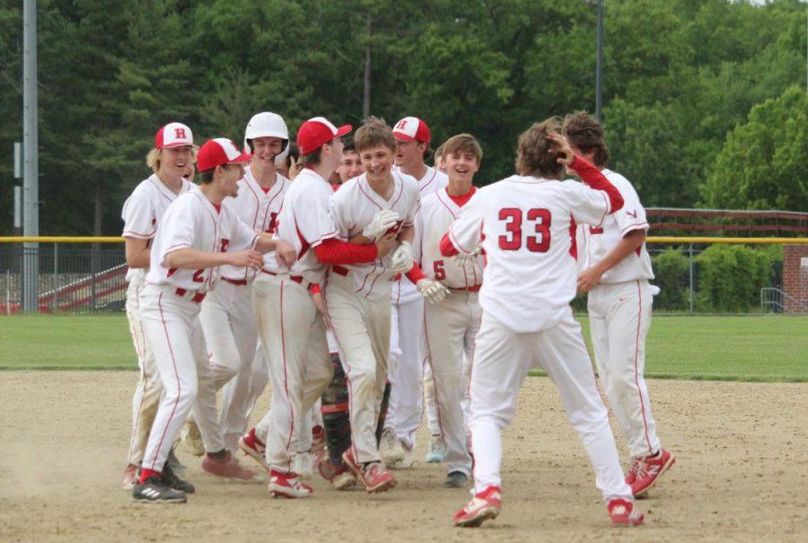 Baseball team celebrates after their win  by Brianna Devlin