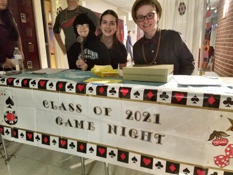 Lauren Lattanzi, Julia Stukonis and Ilan Levine selling tickets to the 8th grade game night in 2017 | Big Red file photo