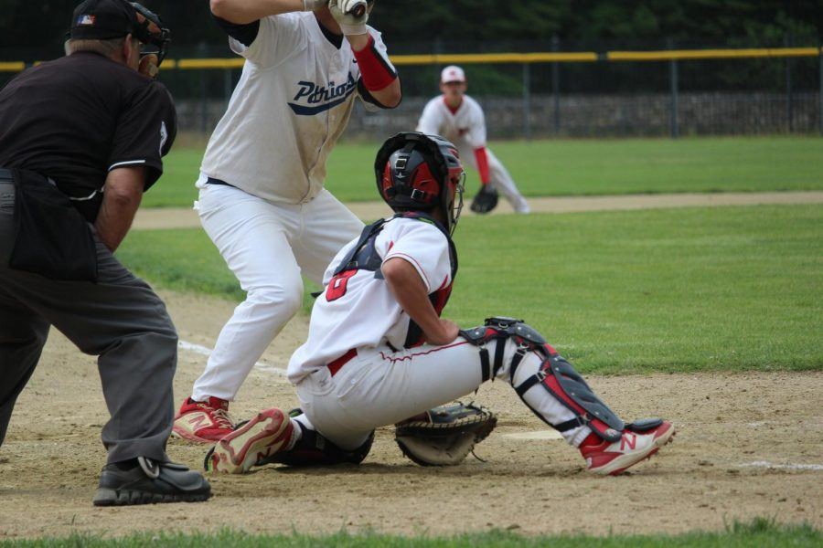 Catcher Mikey Dicarlo (6), waits in anticipation for the ball  by Brianna Devlin