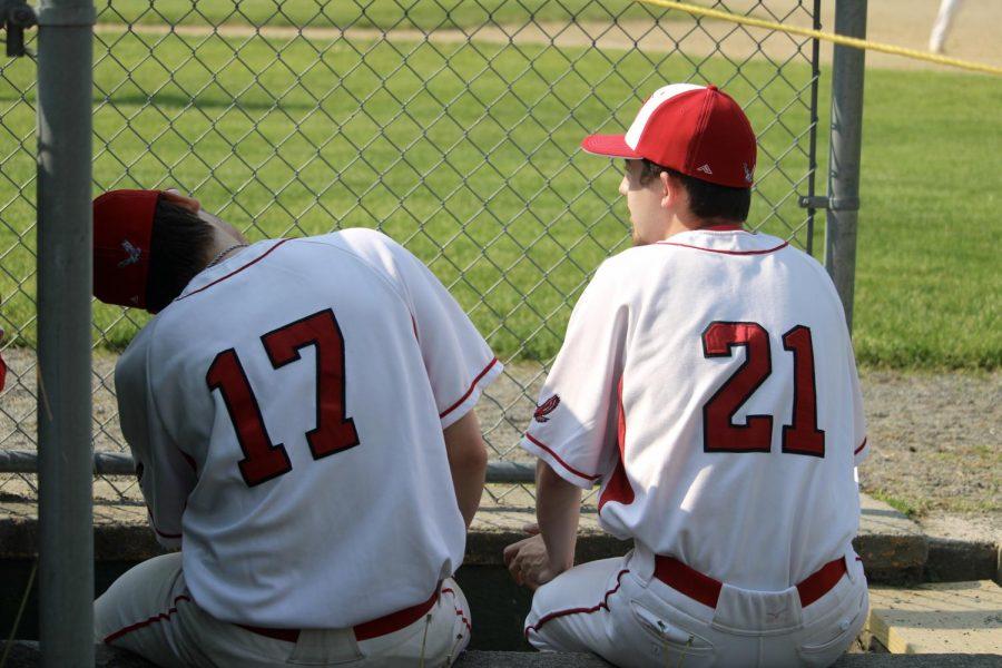 Alex Ried (17) and Alex Smolowitz (21) sitting in the dugout  by Brianna Devlin