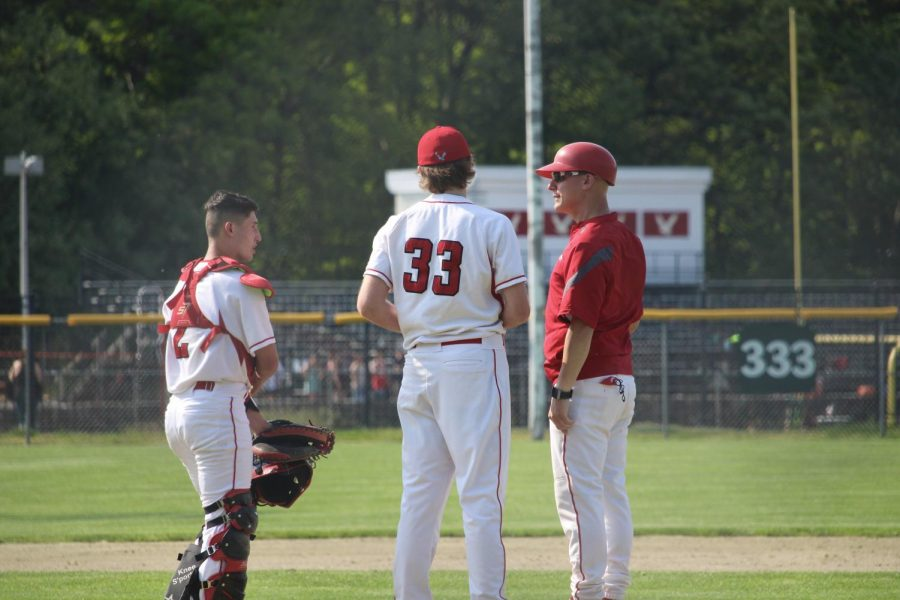 Catcher Nick Tinglof and  Talk to coach Reignhart about the game  by Brianna Devlin